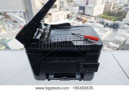 red screwdriver on printer for repair assistance
