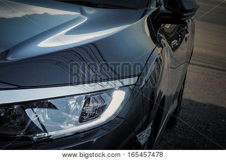 Headlights Of Car On Car Parking, Closeup Shot