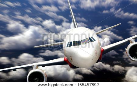 Airplane flying from nose view with cloudy sky
