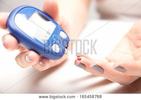 Woman Hands Testing High Blood Sugar With Glucometer