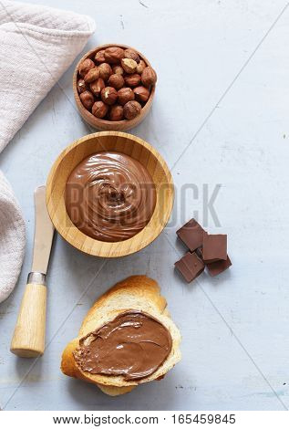 Chocolate paste spread with hazelnuts and bread for breakfast
