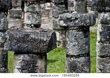 Stone columns at Chichen Itza. Mayan site.
