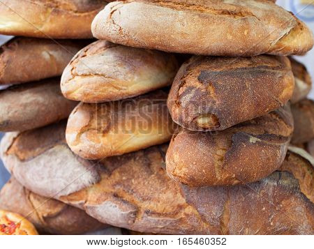 Apulian bread in stack on sale in the market.