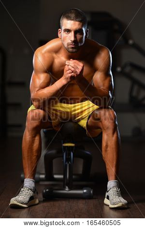 Man Rests In Gym After Having A Workout