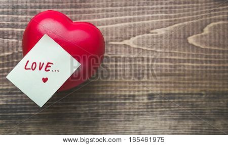 Valentine Day with Heart and Notepad on Wooden with Copy Space