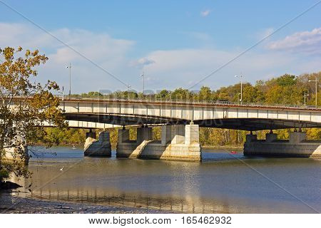 Theodore Roosevelt Memorial bridge in autumn Washington DC. Potomac River provides opportunity for relaxation and recreation in urban settings.