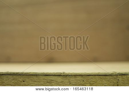 Empty top of wooden table or counter and blured wood background.For product display