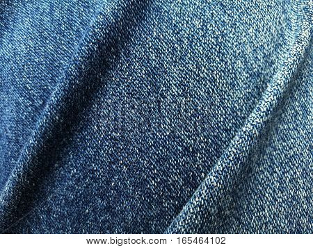 Close up blue jeans denim fold background and texture