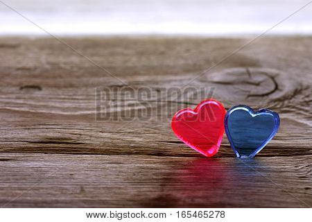 valentine's day background transparent red and blue heart on an old wooden table