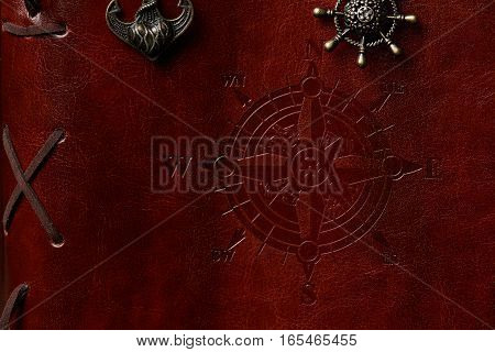 Closeup of brown leather book cover for ship with sides of world