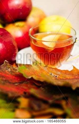 Tea With Lemon In A Cup On The Table With Apples