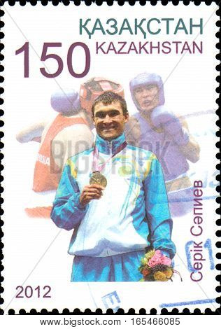 KAZAKHSTAN - CIRCA 2012: Postage stamp printed in Kazakhstan shows Olympic champion Serik Sapiev, who won the gold medal at the XXX Summer Olympics in London