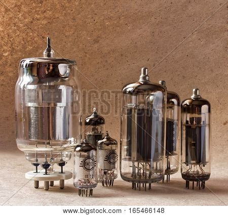 composition of different electronic vacuum tubes on kraft paper background