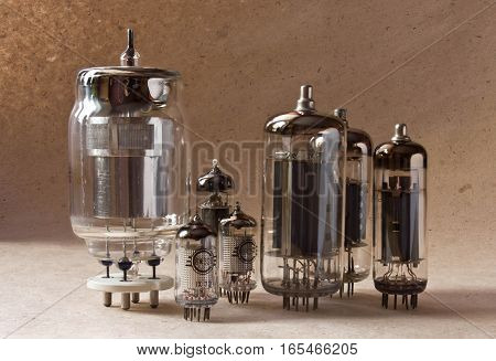 electronic vacuum tubes on kraft paper background in warm colours