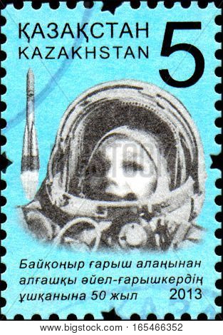 KAZAKHSTAN - CIRCA 2013: Stamp printed in Kazakhstan devoted 50th anniversary of the flight into the space the first woman - cosmonaut from the cosmodrome Baikonur