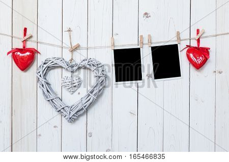 Wooden Rustic Decorative Hearts And Photo Frame Hanging On Vintage Wooden Background With Space.