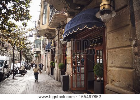 Barcelona, Spain - April 21, 2016: Tourists Are Walking In The Streets Of Barcelona.