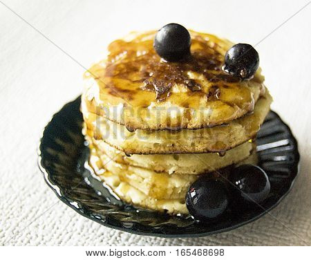 pancakes with syrup honey berries pancakes on a saucer