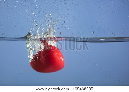 Heart splashing in water as a love symbol