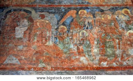 Old murals with religious subjects in an Orthodox church in Yaroslavl, Russia, are not restored and become unusable over time