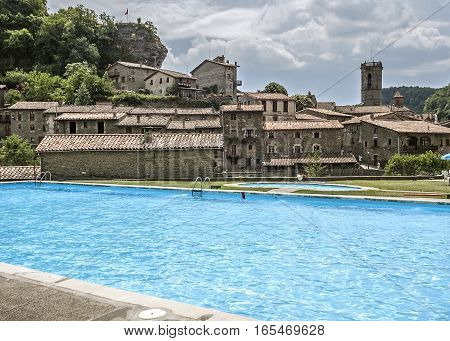 Spain Catalonia. Rupit - a small ancient town of stone in the territory of the Natural Park of the volcanic Garrotxa. Public pool.
