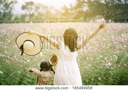 mother and child daughter breathing fresh air in a green forest in summer
