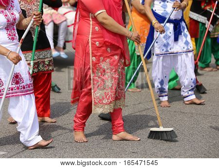 Barefoot Women Sikh Sweep The Road During The Ceremony Along The