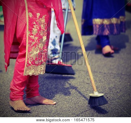 Many Barefoot Women Sweep The Road During The Ceremony