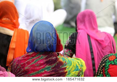 Woman With A Headscarf To Cover Her Head During A Gathering Of P