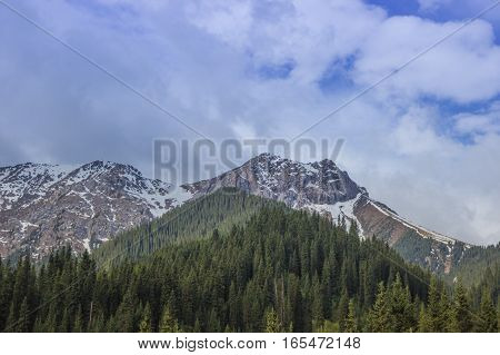 Mountains with ice peaks and cloudy sky Central Tien-Shan Kazakhstan.
