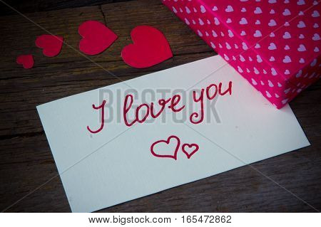 I Love You Handwritten On White Paper And Hearted Gift Box