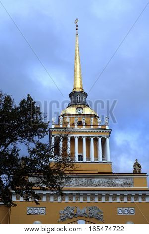 The tower with a spire, a clock and a ship. Admiralty. Alexander Park. St. Petersburg. Russia.