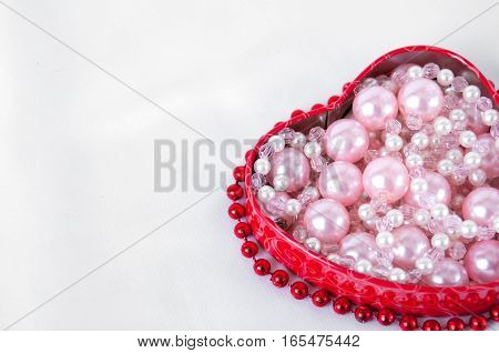 Pink Pearls In A Red Box In The Shape Of Heart