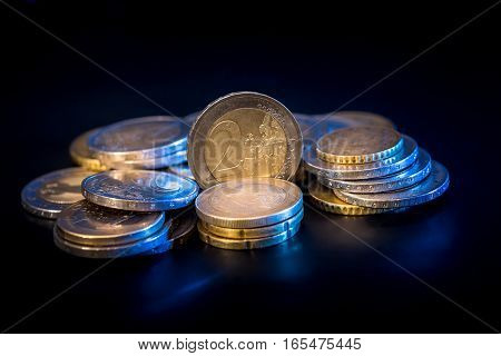 Concept of stacks Euro Coins isolated on black background.