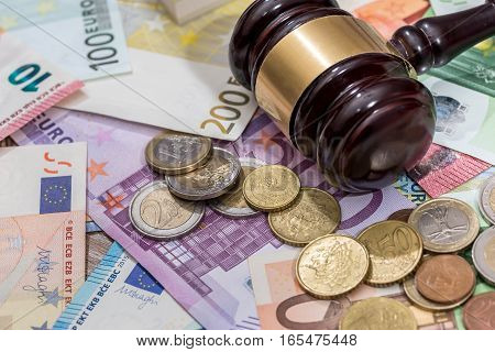 law hammer on euro coin and bills.