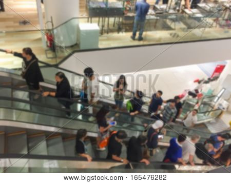 Abstract blur . People in motion in escalators