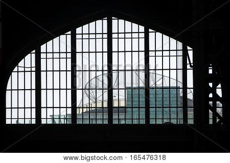 View through a window in the hamburger main station to the roof arena at the sport department store in the Moenckebergstrasse an example of modern industrial architecture