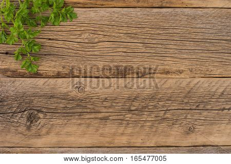 parsley on an old wooden table. Top view.