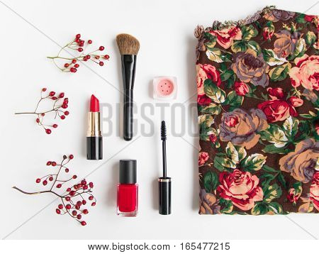 Woman Cosmetics And Bright Top Decorated With Berries On White Background. Red Colors, Flat Lay, Top