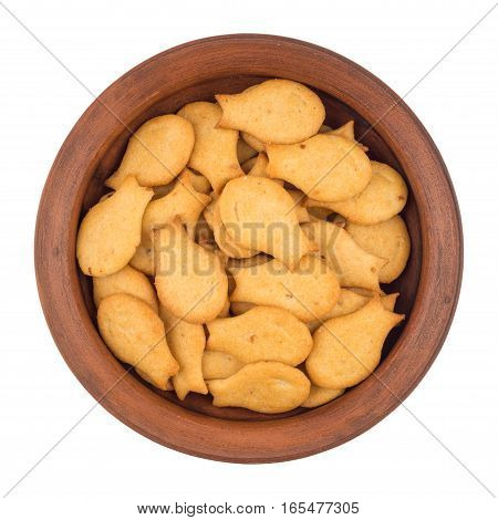 Goldfish Crackers in brown bowl. Isolated on white background. Top view.