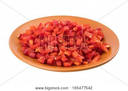 Sliced red pepper in a brown ceramic plate. Isolated on white background.Selective focus