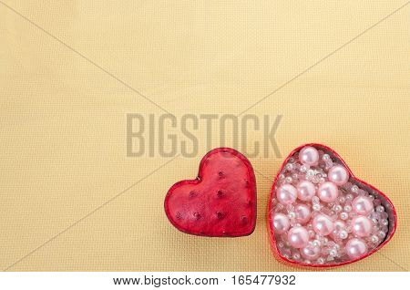 Hearts And Box With Pink Pearls On A Yellow Background