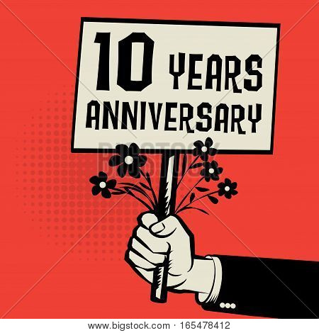 Poster in hand business concept with text 10 years anniversary vector illustration