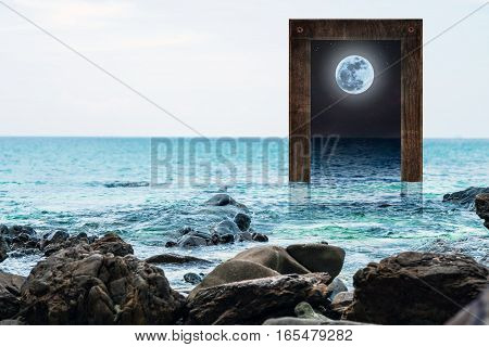 Seascape with wooden frame with full moon at night