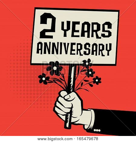 Poster in hand business concept with text 2 years anniversary vector illustration