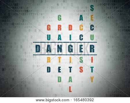 Safety concept: Painted blue word Danger in solving Crossword Puzzle on Digital Data Paper background