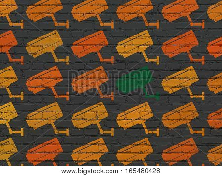 Security concept: rows of Painted orange cctv camera icons around green cctv camera icon on Black Brick wall background