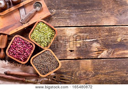 Various Dried Beans With Kitchen Utensils