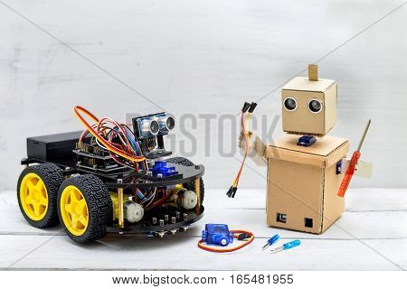 two robots are on the table robots screwdrivers wires servo