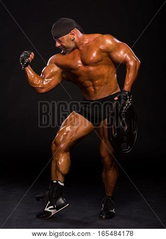 Handsome Bodybuilder Posing In Studio